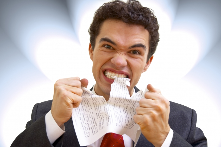 guy-eating-paper-in-frustration-small